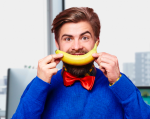 Man in office with a banana